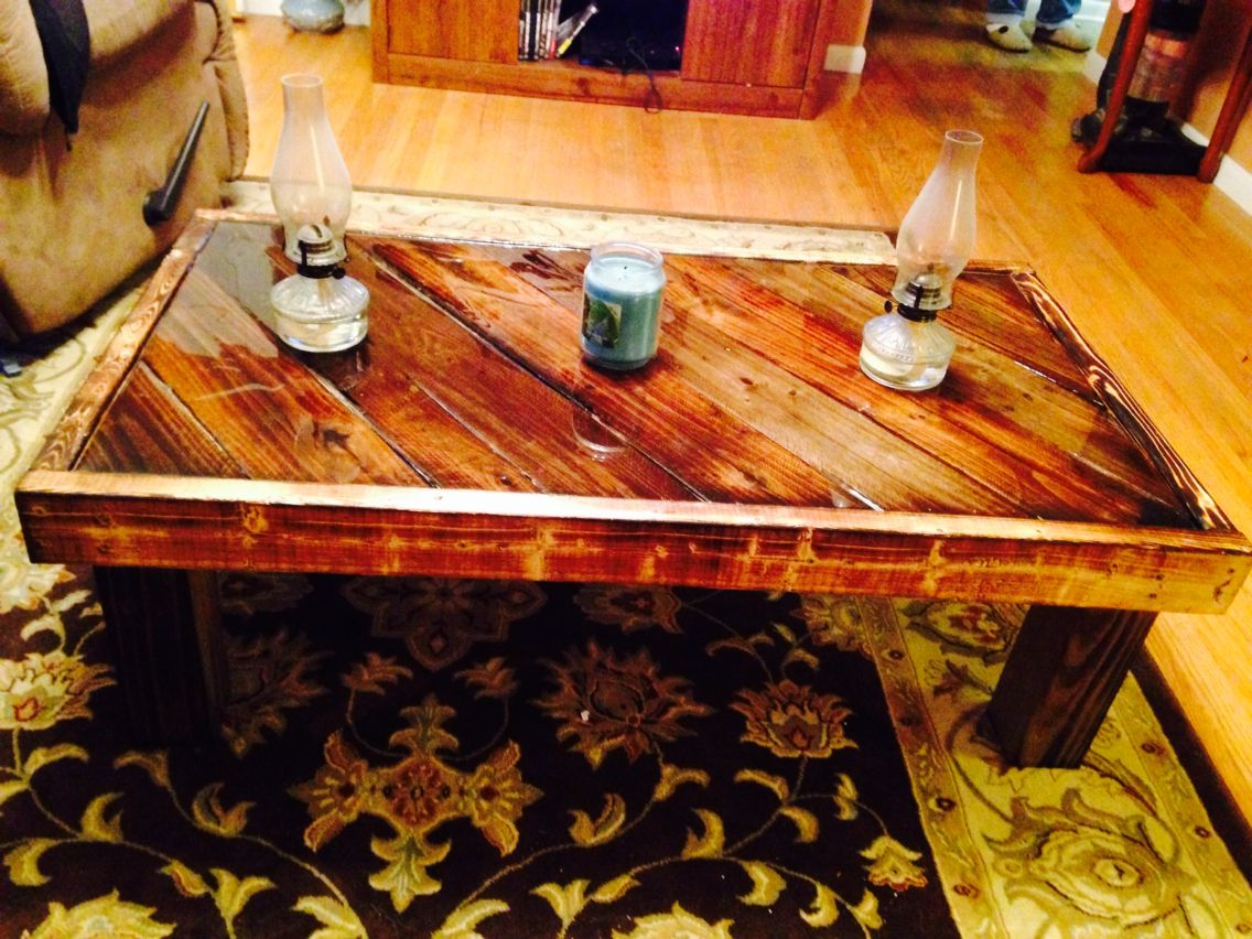rustic coffee table built with old pallet wood finished with