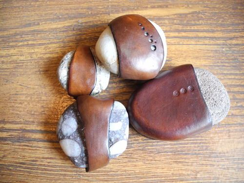 Leather wrapped rocks Cool~~ would make great paper weights-SR
