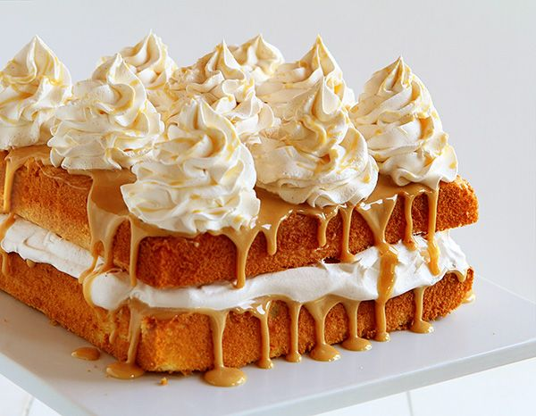 SHOW STOPPING CAKE! The beautiful cake is a Caramel Cake with Caramel Icing and Apple Cider Cinnamon Whipped Cream. Shut the front door. AMAZING!