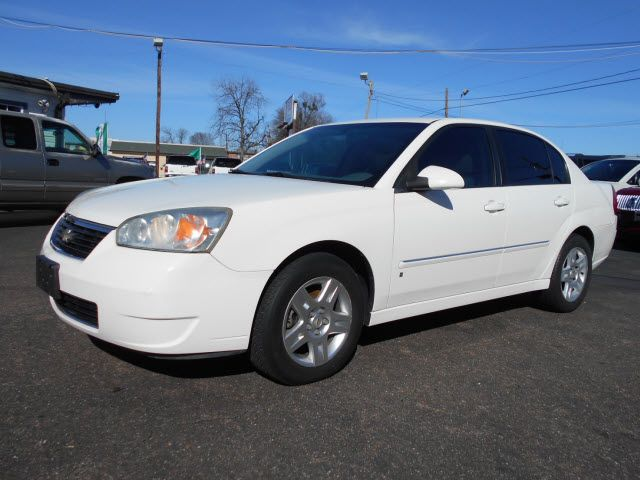 White 2006 Chevy Malibu tinted Windows mine now please