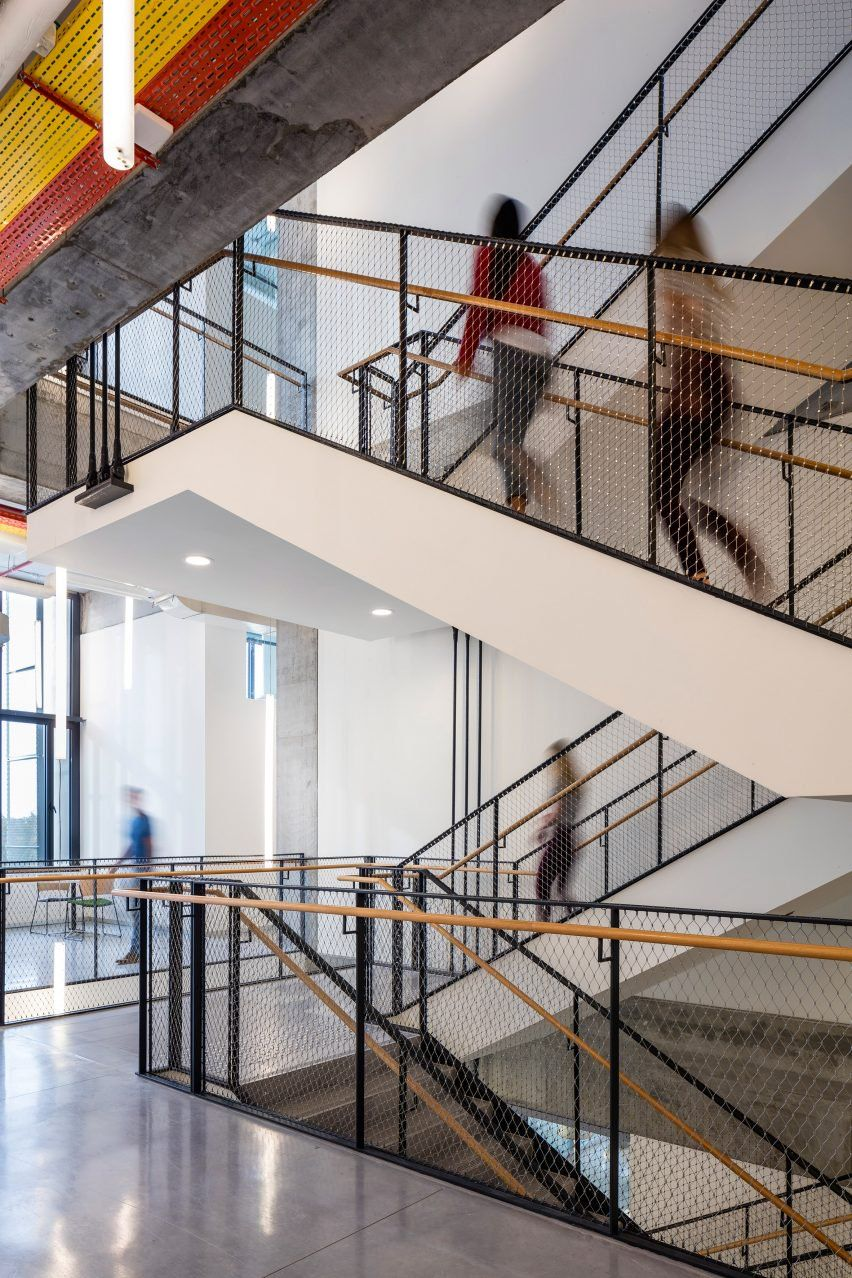 This Uspended Steel Staircase Connects Three Storeys Of The School Railing Design Stairs Design Stair Railing Design