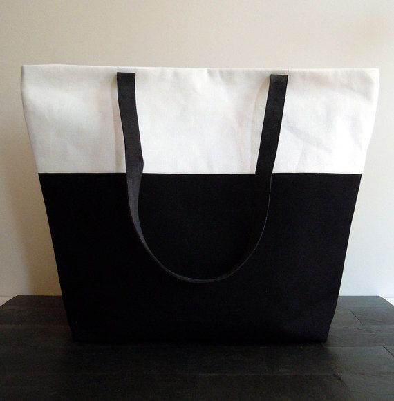 Black and white canvas bag with leather handles
