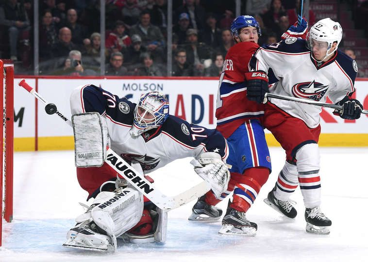 1.26.16 - Columbus Blue Jackets vs. Montreal Canadiens MONTREAL, QC - JANUARY 26: Joonas Korpisalo #70 of the Columbus Blue Jackets blocks the shot the Montreal Canadiens in the NHL game at the Bell Centre in Montreal, Quebec, Canada. (Photo by Francois Lacasse/NHLI via Getty Images) *** Local Caption **Joonas Korpisalo;Brendan Gallagher;Ryan Murray