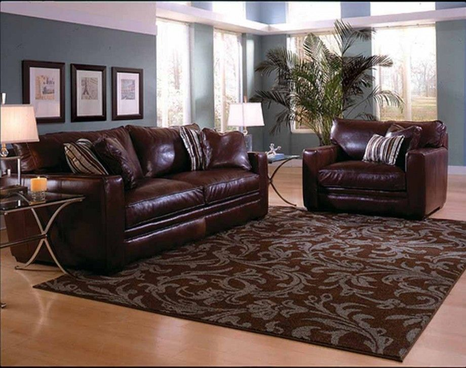 Living room rugs ideas with dark brown sofa with awesome area rugs glasses table and natural for Pictures of living rooms with brown furniture