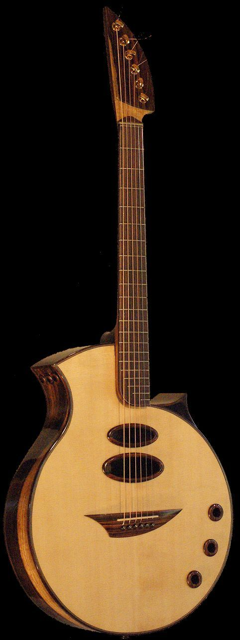 Ernie Rissmann Roundar Guitar. RESEARCH #DdO:) - https://www.pinterest.com/DianaDeeOsborne/instruments-for-joy/ - INSTRUMENTS FOR JOY. Ouch, this was a hard one: Almost all the sources I found were in German even when I asked for English! FOUND: This unique acoustic guitar with an odd body is made in Münster, Germany. Since 1994 the luthier builds in small workshop. He learned craft at Hartmut Hegewald in Bönen. Each instrument is a custom creation made with high quality, seasoned tonewood.