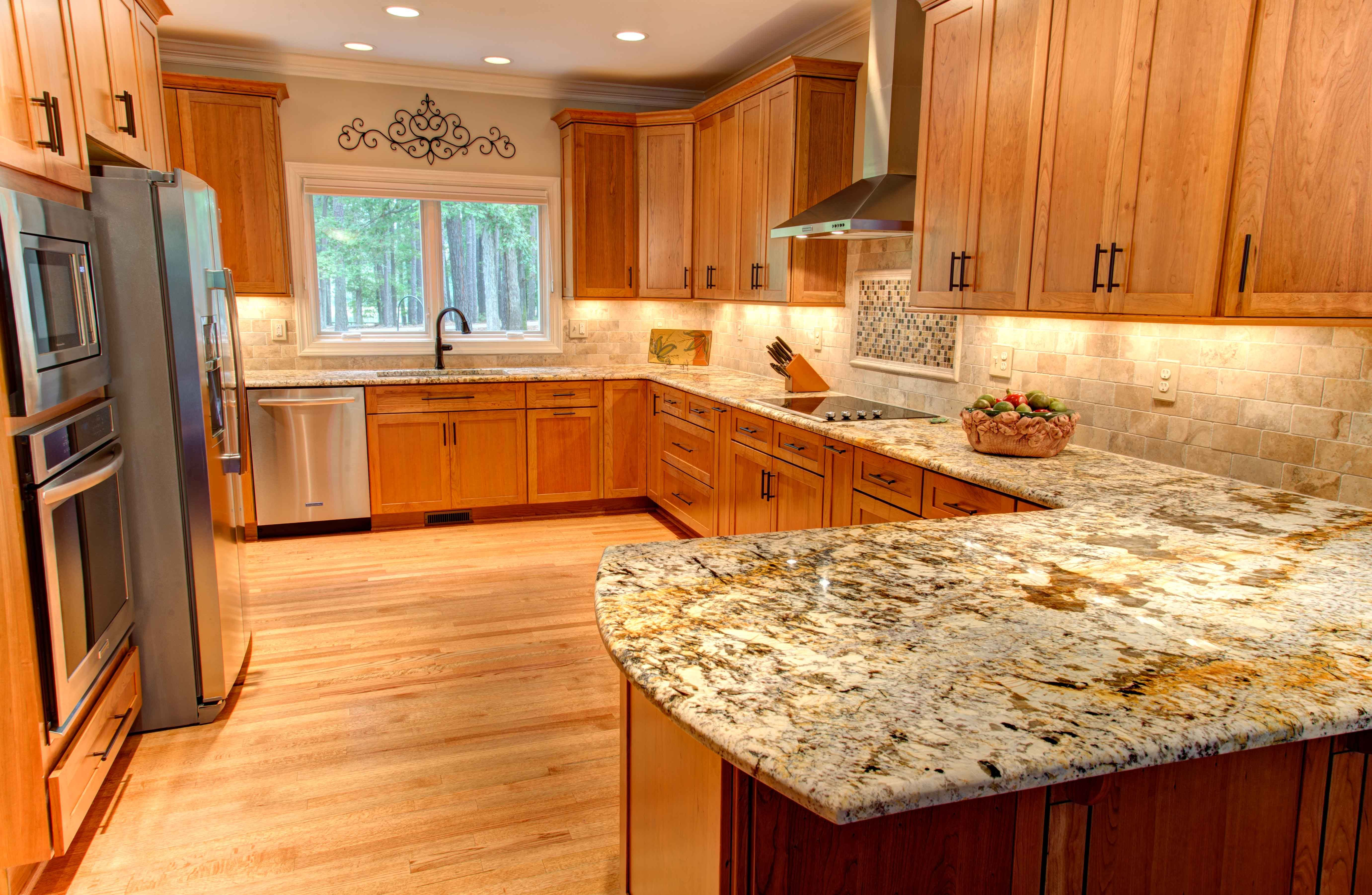 The structure and the color of oak through brown color of ... on What Color Granite Goes With Honey Maple Cabinets  id=39202