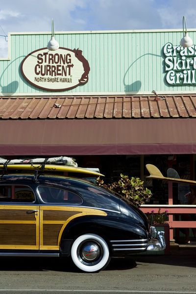 Grass Skirt Grill with vintage car parked outside