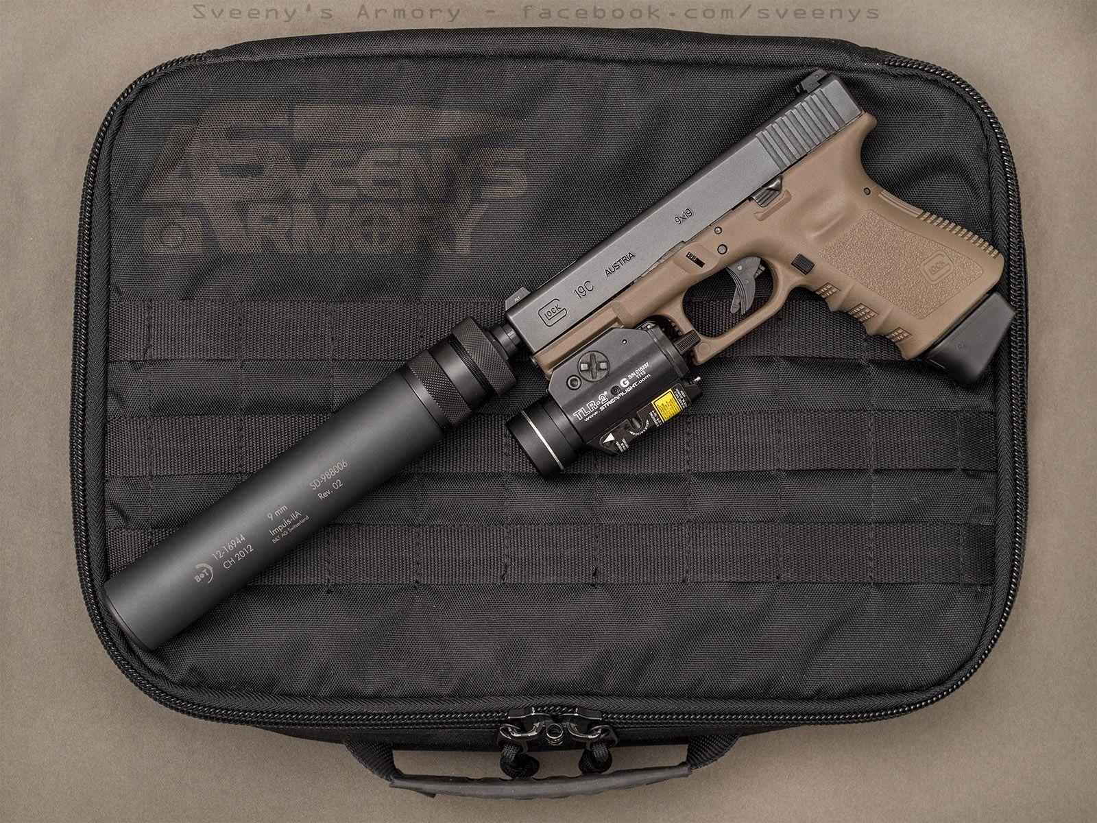 Glock 19 with suppressor and laser/light [1600x1200][OC] | Glock