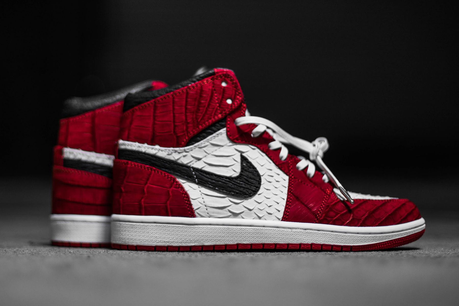 0462ab1e9a01cb The Shoe Surgeon Offers up Another Pair of Exotic Custom Air Jordan 1s.  Snakeskin kind of design on shirts  chopped pattern