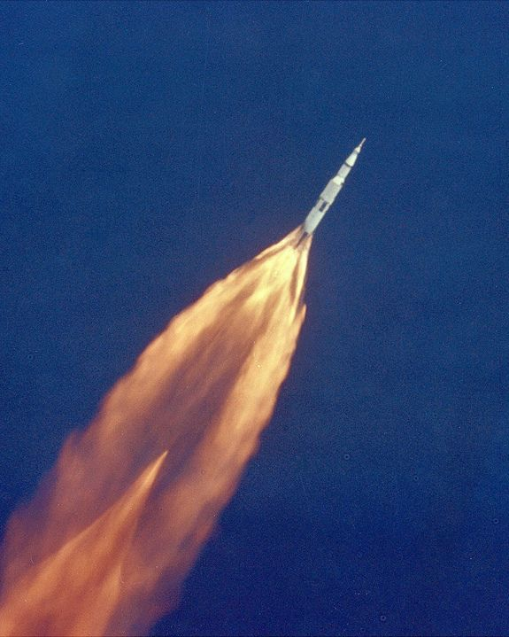 Apollo 11 Launch - The Apollo 11 Saturn V space vehicle climbs toward orbit on July 16, 1969, bearing astronauts Neil A. Armstrong, Michael Collins, and Edwin E. Aldrin, Jr.  Armstrong and Aldrin would make history as the first men on the moon,