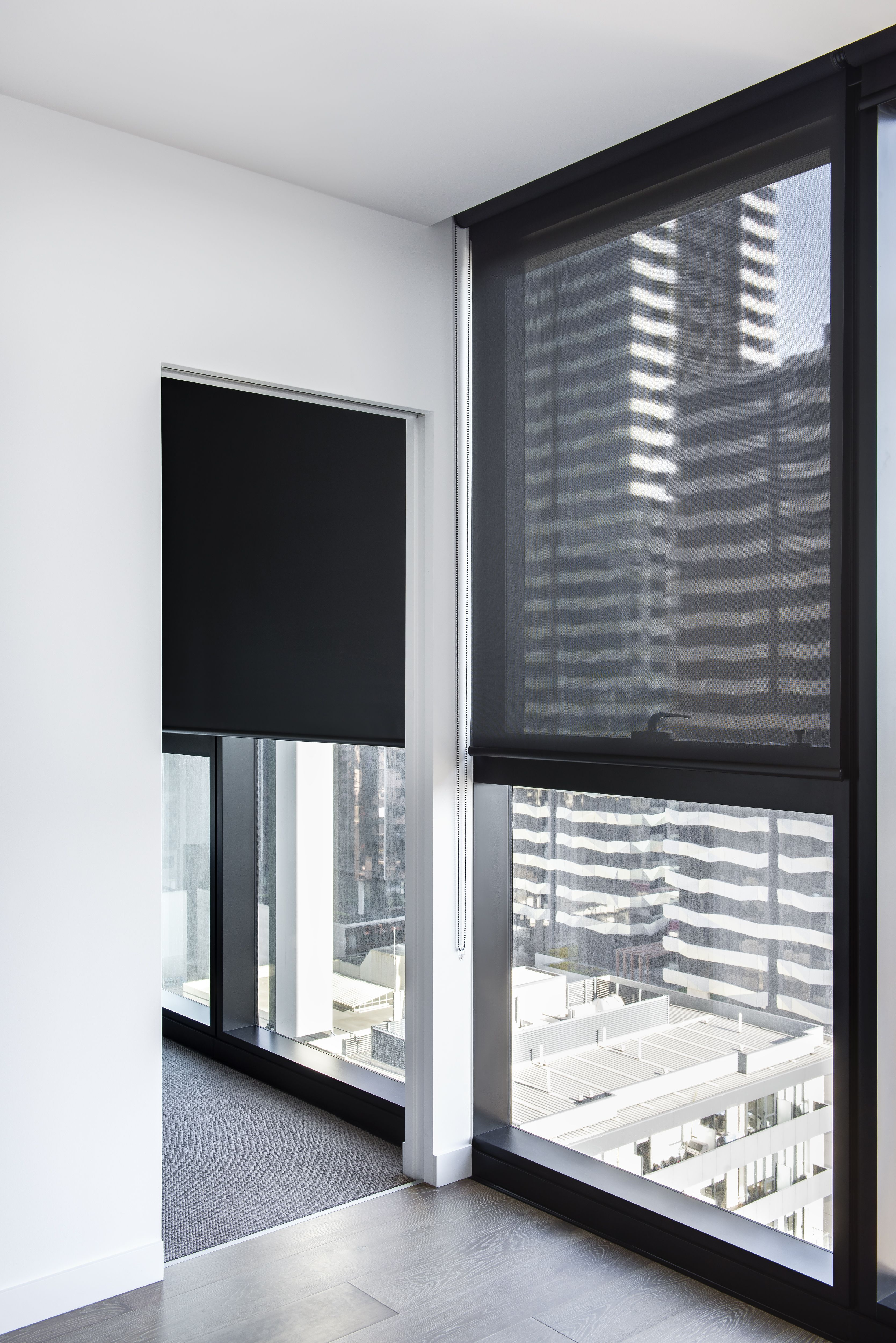 Single roller blinds in solitaire u onyx blockout fabric left and