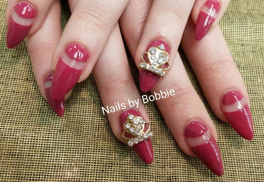 Mixed red and tan opi infinate shine colors together to get this beautiful dark pink. Talon nails with open space and crown embellishments on accent nails!