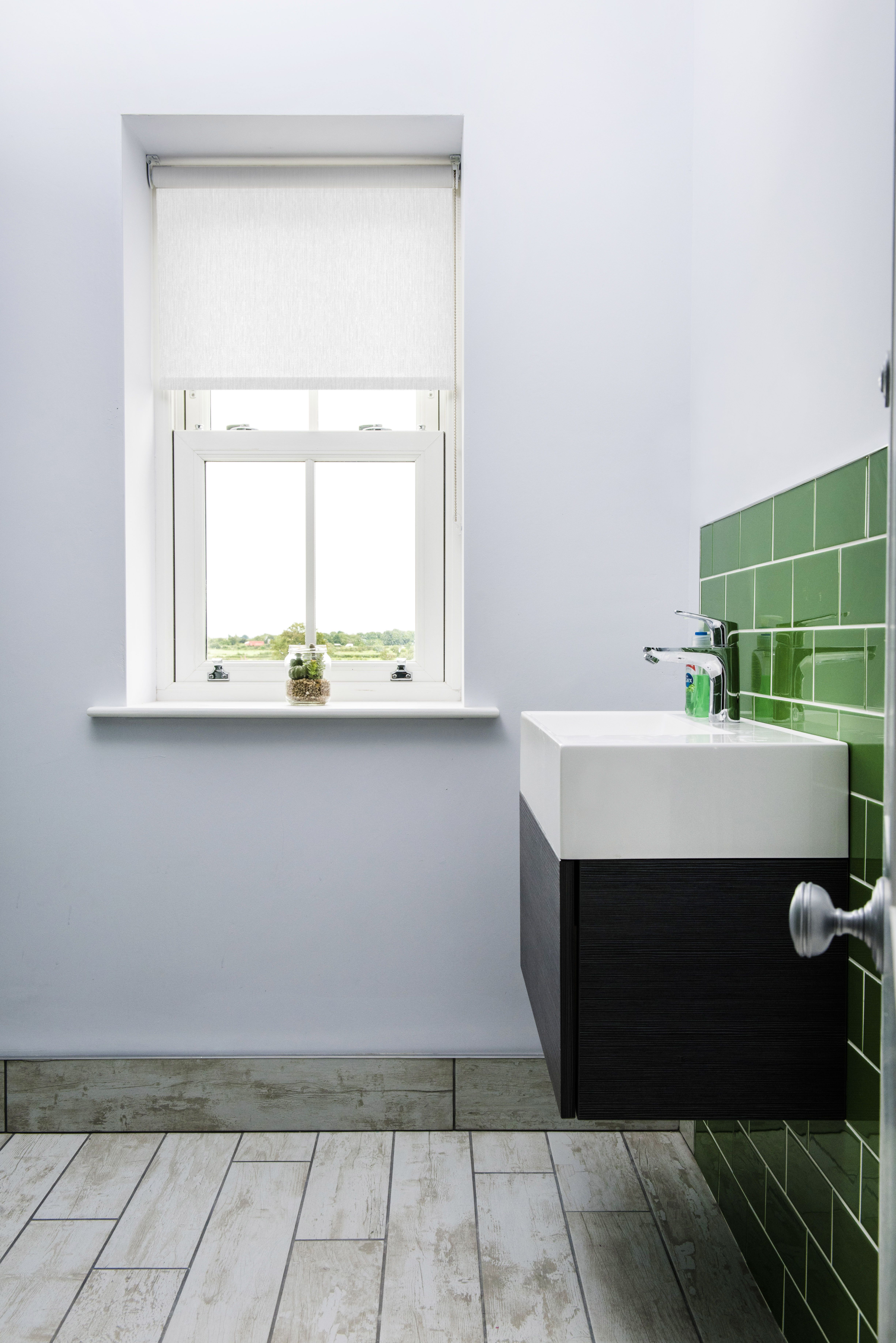 White roller blind in this gorgeous white and green bathroom ...