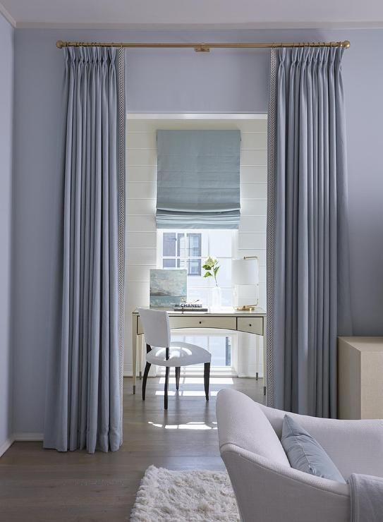 Gray Curtains On Aged Brass Drapery Rods Open To A Home