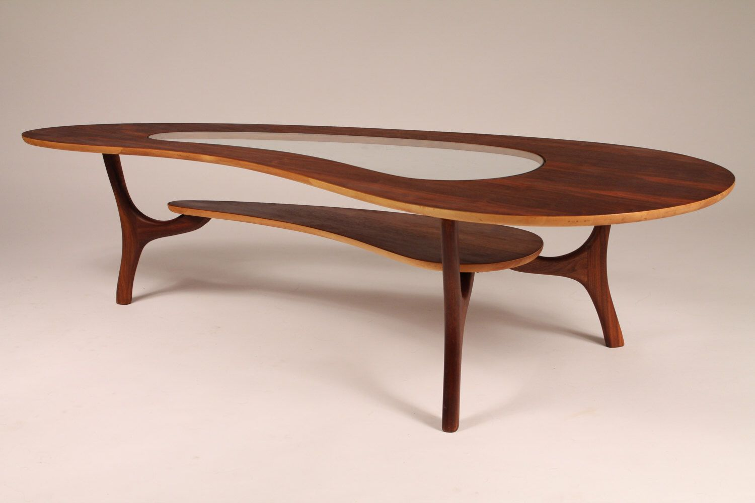 1960 WALNUT COFFEE TABLE veneer kidney shaped with center glass