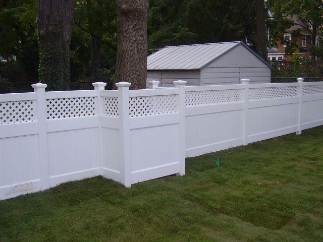 48 Infinity With Privacy Lattice Top Vinyl Pvc Fence Boxing Out A Tree Fabricated And Installed By Liberty Fence Railing Pvc Fence Fence Gate Vinyl Fence