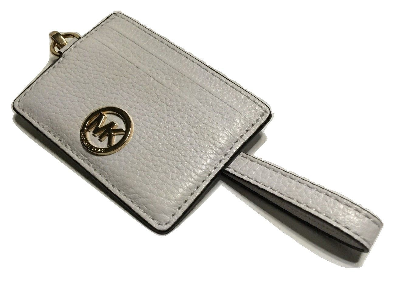 dd19bfd534ba33 Michael Kors Fulton Metro Pass Case Leather Optic White Wristlet. Get the  trendiest Clutch of the season! The Michael Kors Fulton Metro Pass Case  Leather ...