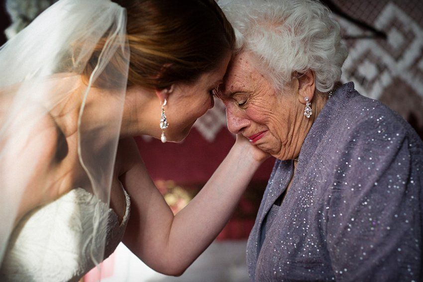 Beautiful breathtaking emotional moment between bride and grandmother