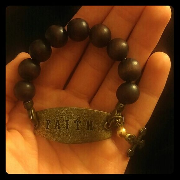 ?Faith Bracelet??? This bracelet is gorgeous! It has a cross charm on it(: I've never worn it. Jewelry Bracelets