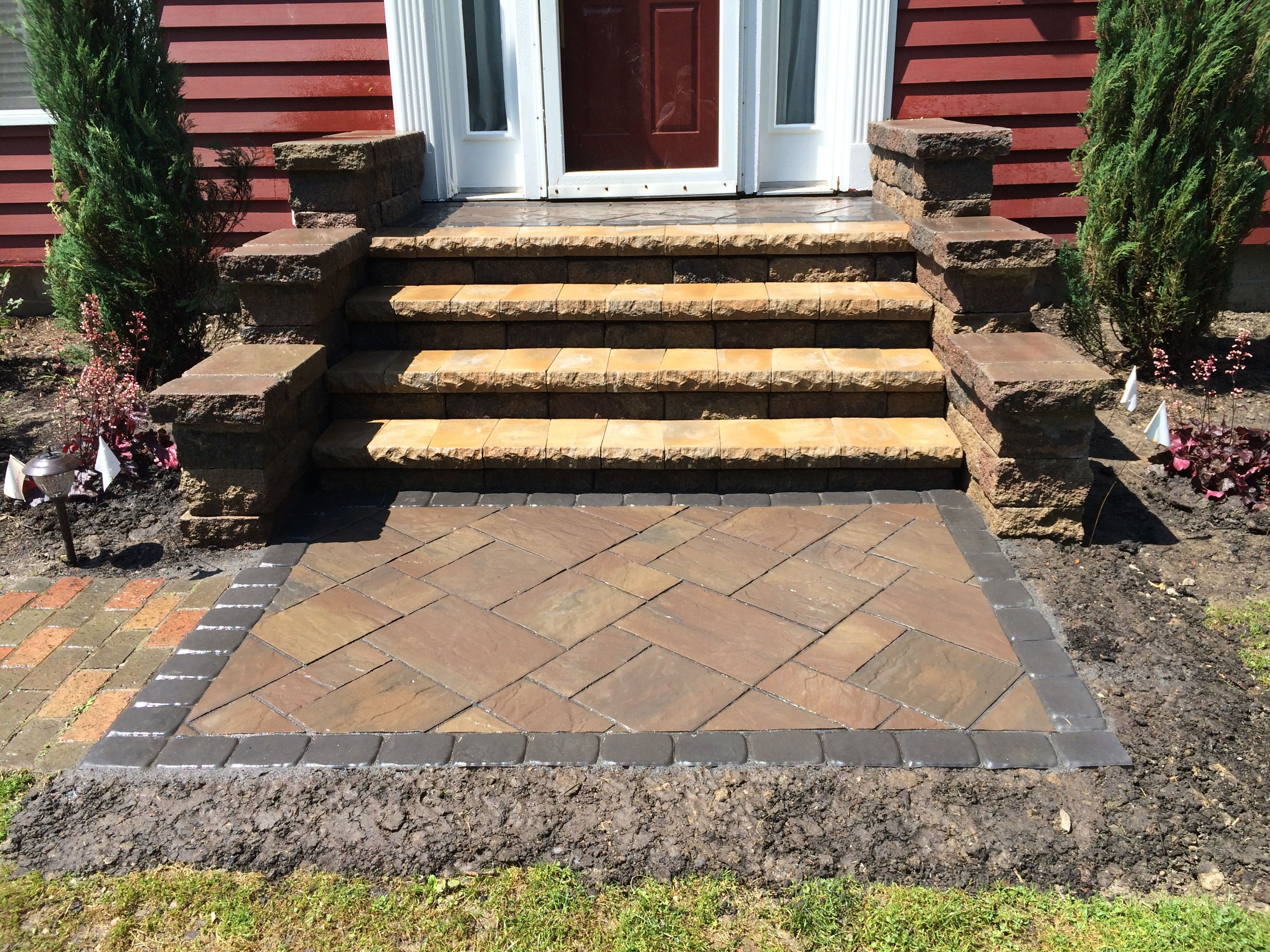 large front stoop constructed using a combination of lampus retaining wall blocks and pavers