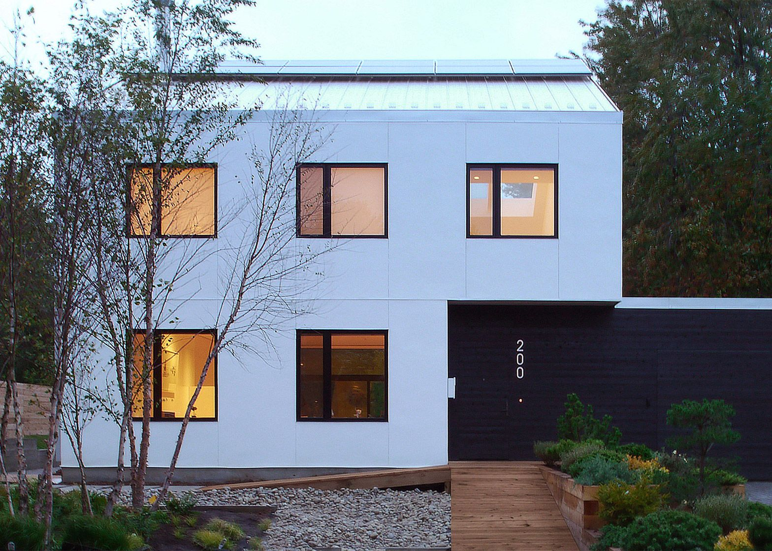 Straw bales insulate monochrome house in Ontario by ...
