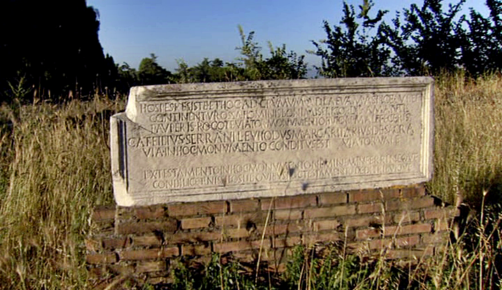"Tomb of a freedman, Gaius Atilius Euhodus, seller of pearls on the Via Sacra, Rome. The inscription reads: ""Stop, oh, traveller, and behold this heap of earth on your left. There lies the remains of a good and merciful man, a lover of the poor. Gaius Ateilius Evhodus, freed man of Serrano, seller of pearls on the Via Sacra"". The monument dates from the first half of the first century BCE. Via Appia."