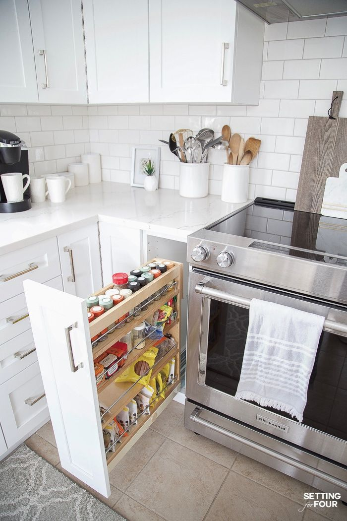 Our Dark to White Kitchen Remodel Before and After is part of Lower Cabinet Organization - See our Dark to White Kitchen Remodel Before and After! See the kitchen refacing project, dark wood cabinets to new white cabinets & quartz countertops!