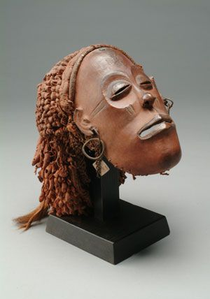 Africa   Mask (mwana pwo) from the Chokwe peoples   Probably late 19th century   Wood, tukula powder, clay, string, metal, fur, snakeskin, cloth