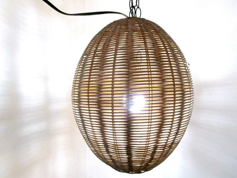 Add a touch of boho decor to your patio with a vintage wicker lamp. It adds texture and interest to any space! #patioideas #patiodecor #homedecor #vintage #vintagewicker #pendantlight #affiliate