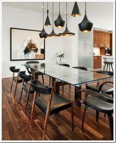 See more table and furniture inspiration for your interior design project! Look for more midcentury home decor inspirations at http://essentialhome.eu/ | #moderndesign #modernfurniture #design #furniture #glasstables #glassdiningtable #diningtable #diningroom #contemporarydesign #contemporary #elegantdesign #blackchairs #blackchandelier