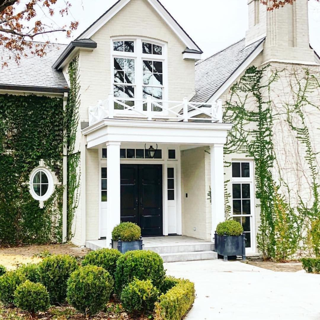 Climbing Ivy Beautiful Boxwoods Painted White Brick Stunning Black Front Door White Exterior Houses House Exterior Facade House
