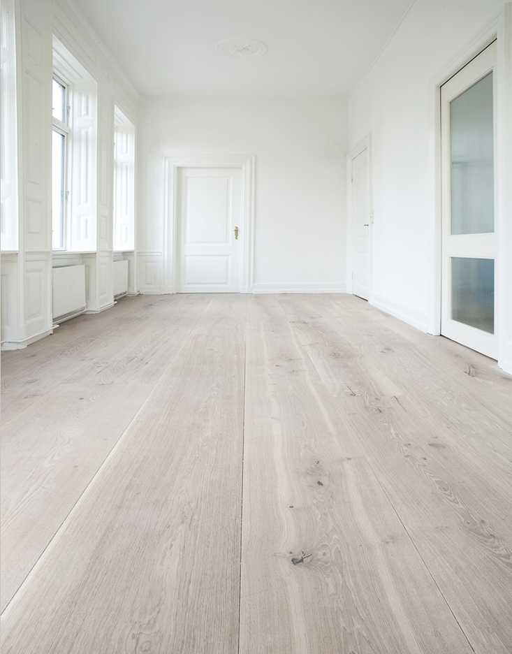White walls, white washed floors and lots of natural light! // Wide Plank  Whitewashed by Dinesen