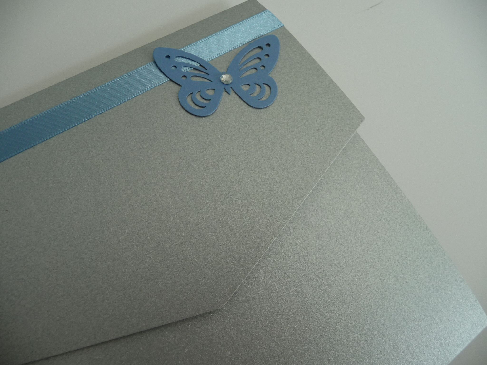 Silver and cornflower blue butterfly themed wedding invitations - pocketfold style