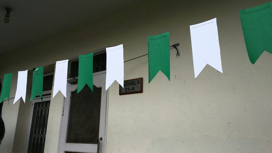 Green And White Buntings Hanging On Independence Day Of Pakistan