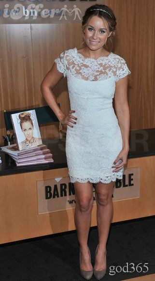 Lovely in a white lace Marchesa dress for a book signing in 2010 ...