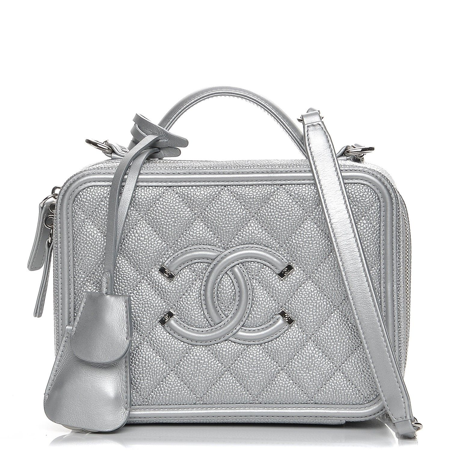 8e453b308d27 This is an authentic CHANEL Metallic Caviar Quilted Medium CC Filigree  Vanity Case in Silver.