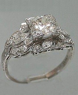platinum art deco filigree engagement ring set in platinum engagement ring holds a round old european cut diamond that weighs ct - 1920s Wedding Rings