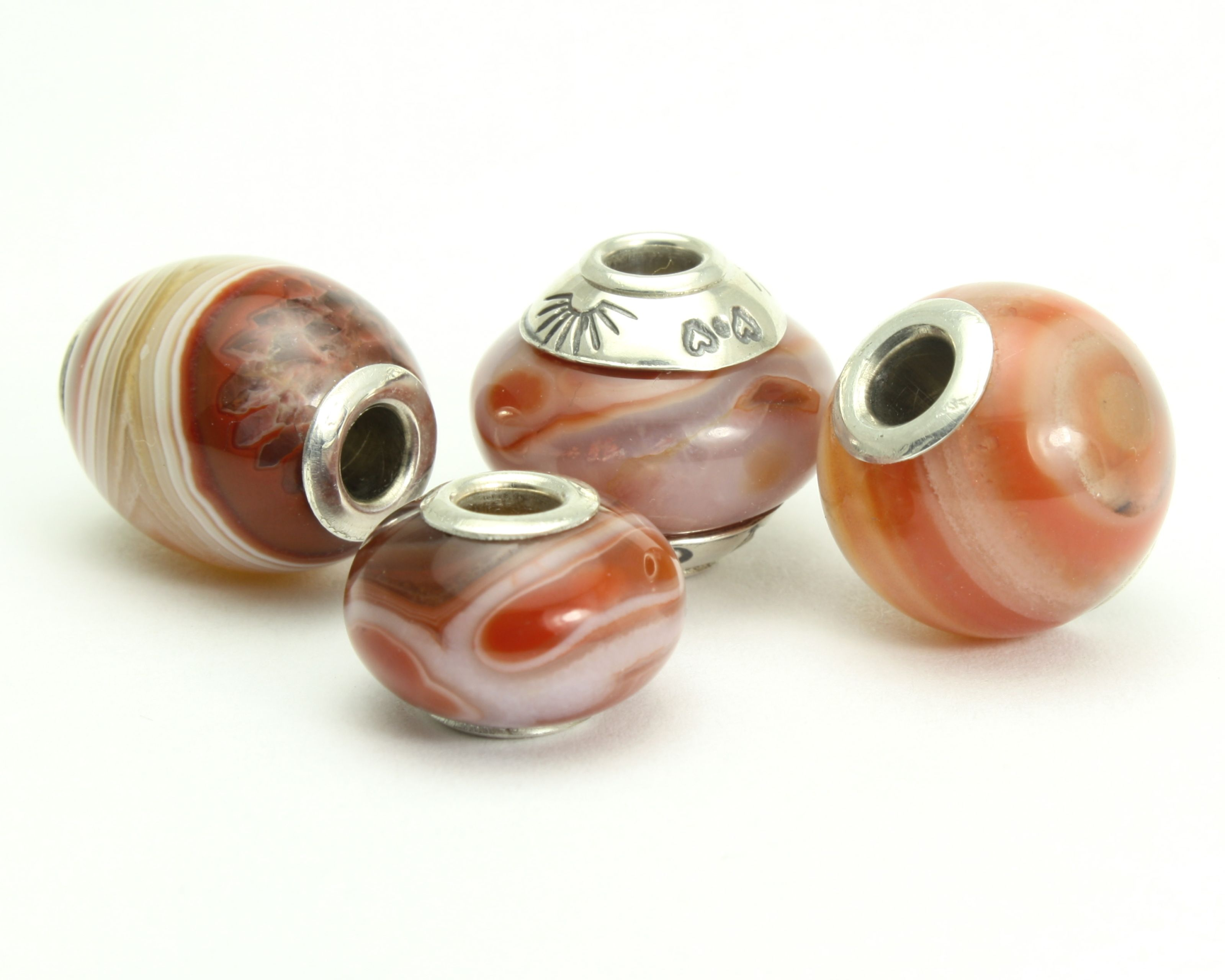 """PREMIUM.Released May 2016.This Lake Superior Agate stone is said to be among the oldest agates in the world and isfound in Wisconsin, along the South Shore and the WesternUpper Peninsula. It can also be found in Michigan and Minnesotaalong the shores of Lake Superior, once named """"Gitche Gumee"""" byHenry Wadsworth Longfellow in his """"Song of Hiawatha"""".No two agates are the same. These are true stunners!NOW AVAILABLE IN A NEW SHAPE - The Marblettes! Theseperfectly round ..."""