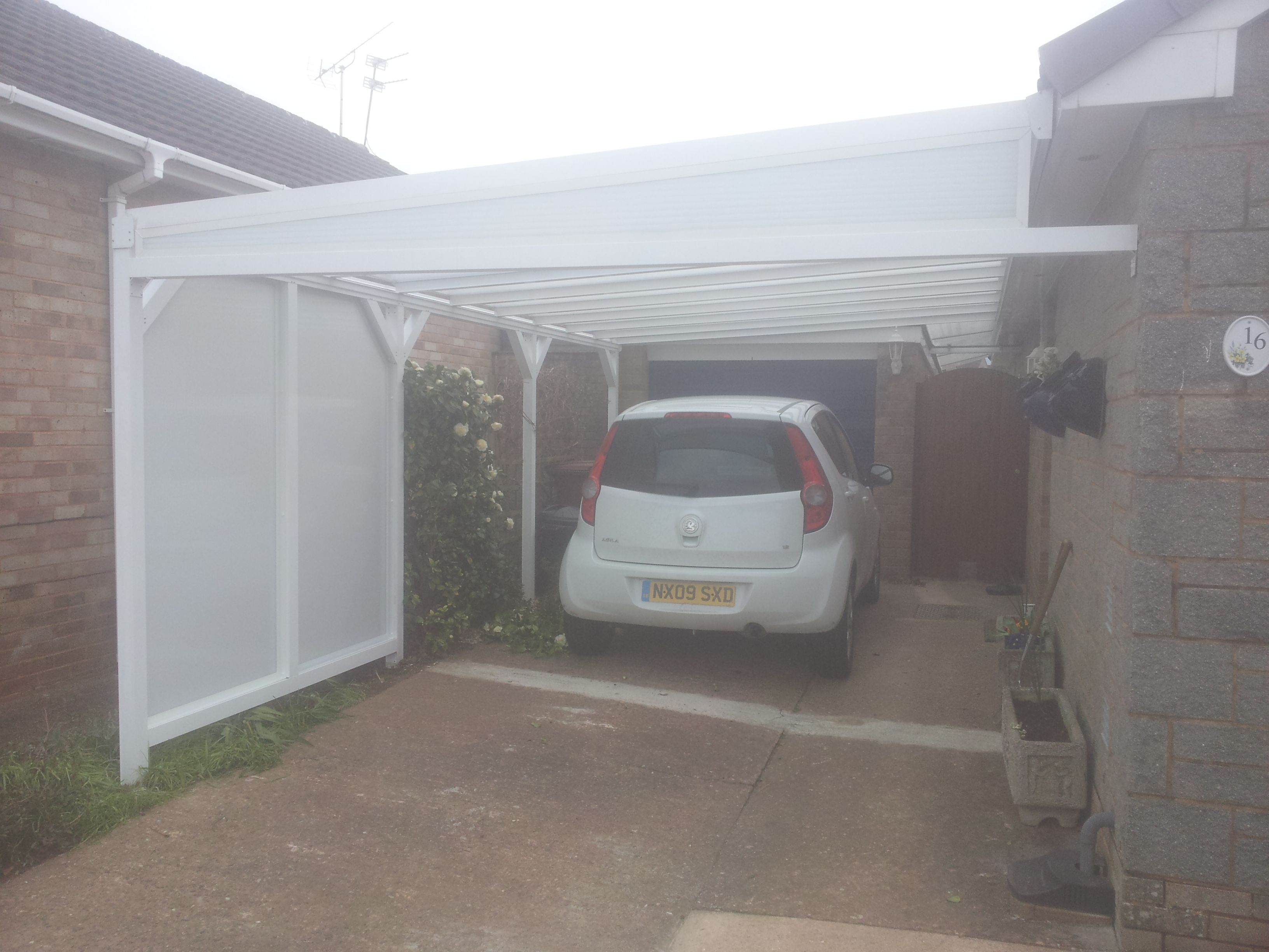 This is a standard wall mounted lean to canopy with side cladding to hide the neighbours & This is a standard wall mounted lean to canopy with side cladding ...