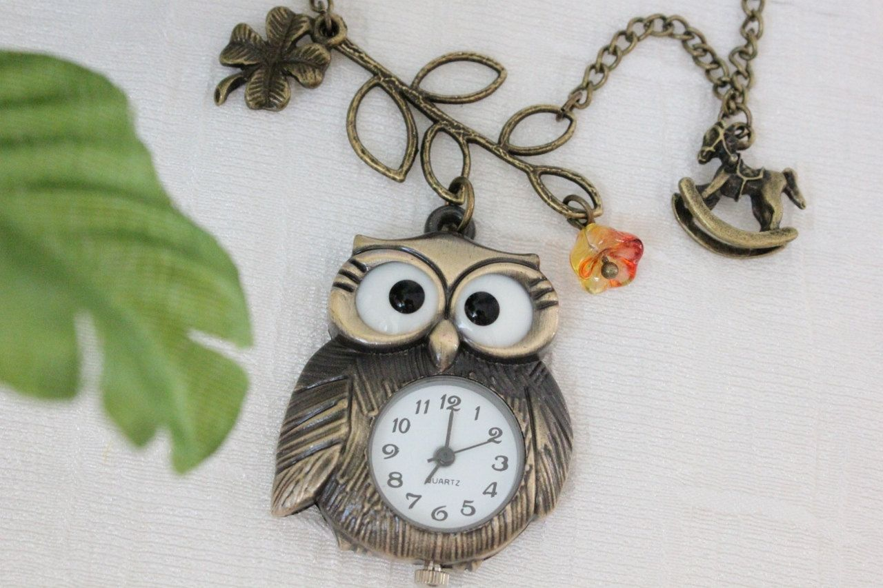 Vintage Style Owl Pocket Watch Necklace with lucky grass, branch, flower and cockhorse charm. $13.80, via Etsy.