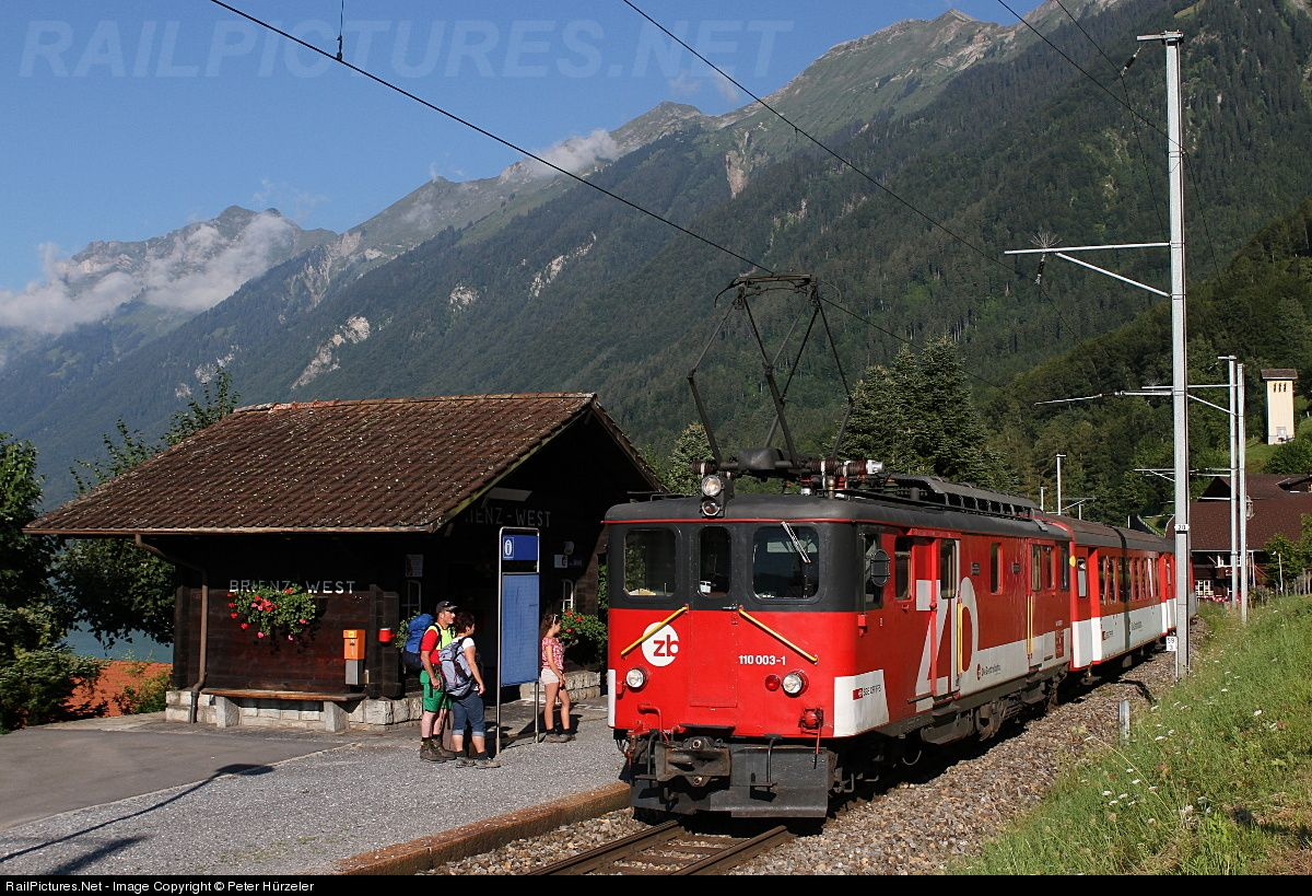 "70 years old and still running..... Delievered as Deh 4/6 910 in 1942, in 1993 the cog wheel was removed and the loco was renumbered into De110 003-1. Here the loco is pulling a regional train into the stopping point ""Brienz-West"". Some hikers are already waiting on the train..."