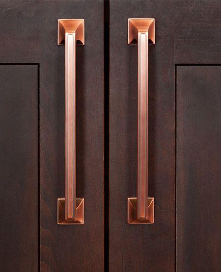Long Solid Brushed Copper Door Pulls Upon A Dark Brown Cabinet Door Copper Kitchen Pul Dark Brown Kitchen Cabinets Dark Brown Cabinets Brown Kitchen Cabinets