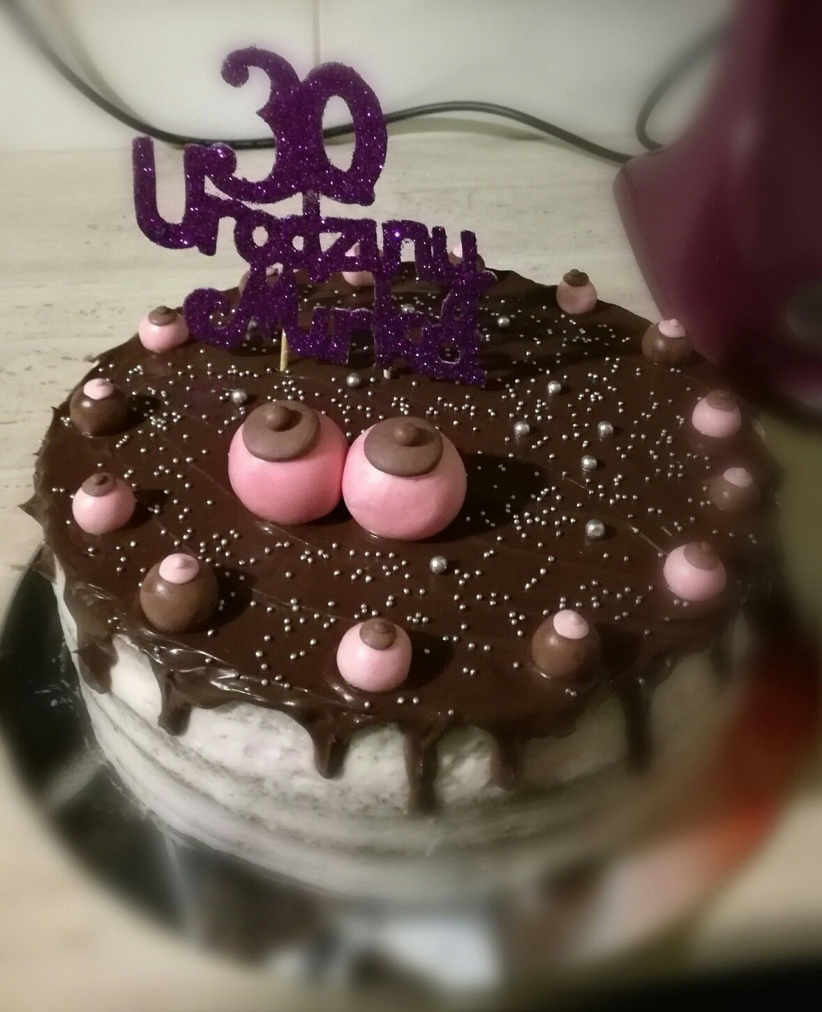 Cake with a lot of boobs for 30ty birthday...cream and chocolate taste
