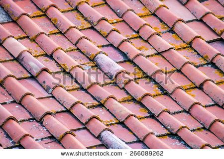 background of an old roof with tiles - stock photo
