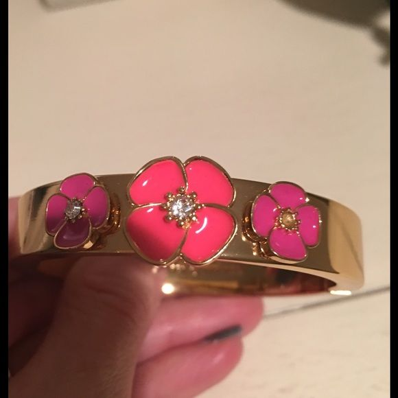 Kate Spade Bracelet Gold bracelet with pink flowers, worn once! Great condition! kate spade Jewelry Bracelets