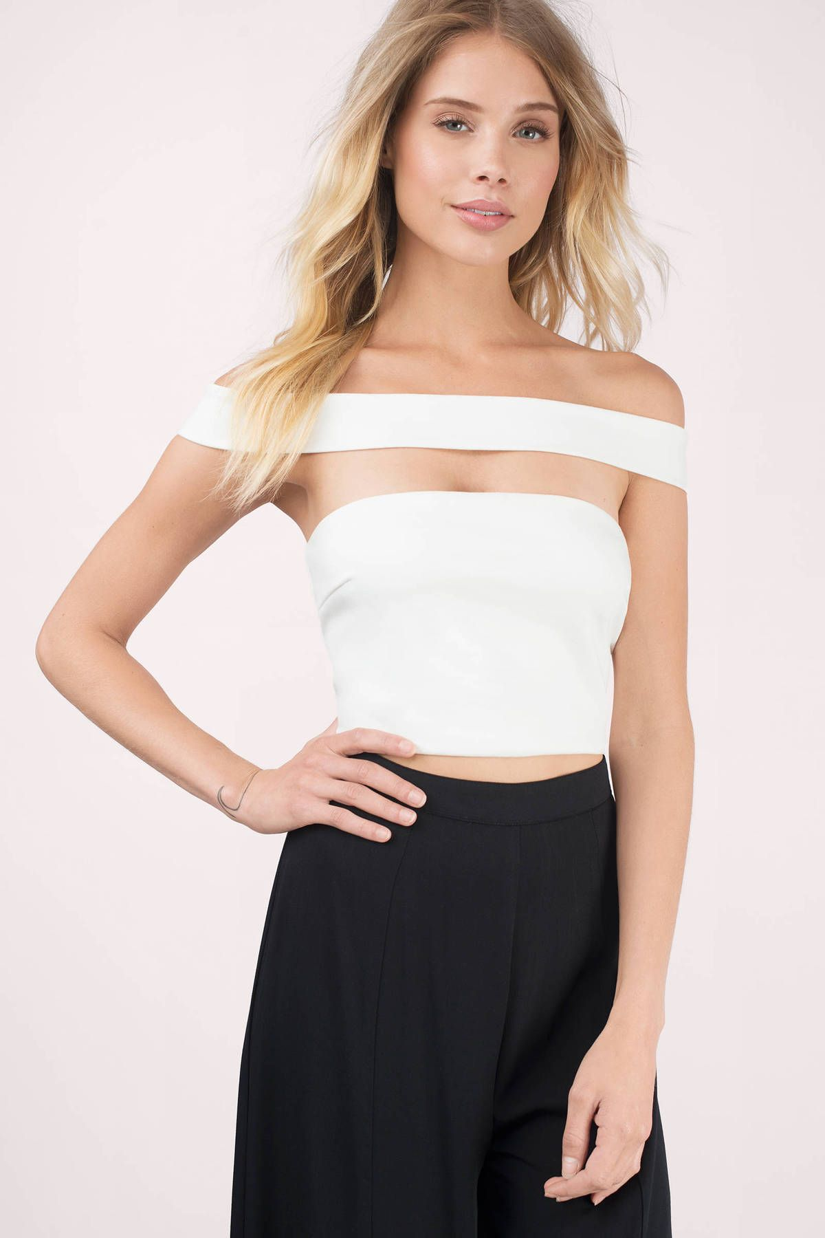 8017d40a154d25 This White Off Shoulder Crop Top features a floating off the shoulder strap  with a back zip up.