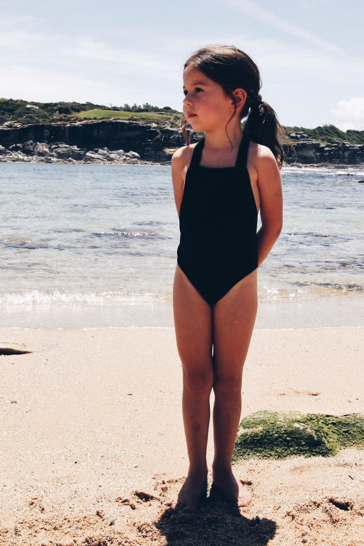 1975280bce430 ... for girls at Casa Blue Swim. Fashionable yet functional swimsuits.  Sizes 3 - 12. Square neckline with secure ties at the back. UV protection,  UPF50+.