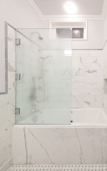 Soaking tub and shower in new bath in Brooklyn Heights Federal row house, designed by CWB Architects.