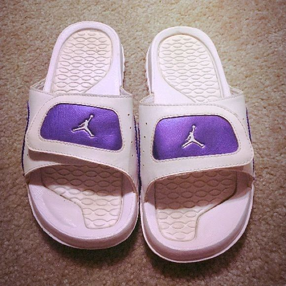 61b6479fe77e56 Jordan sandals White and metallic purple slides. Like new