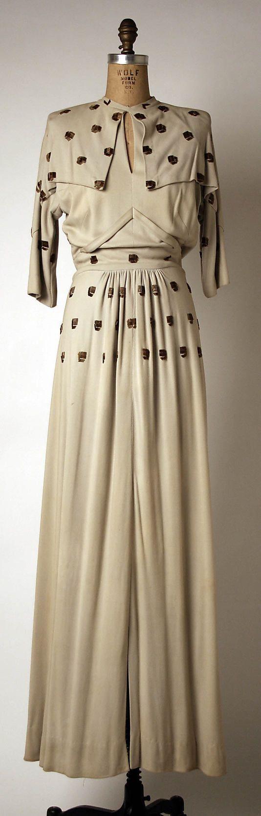 Dress  Gilbert Adrian  (American, 1903–1959)    Date:      ca. 1940  Culture:      American  Medium:      cotton, plastic, silk